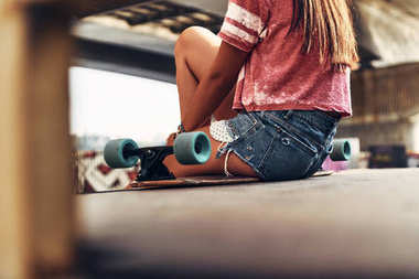 skater girl wearing jeans shorts