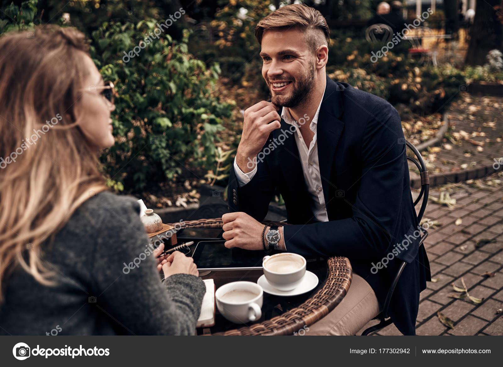 handsome young man having conversation woman restaurant job interview stock photo
