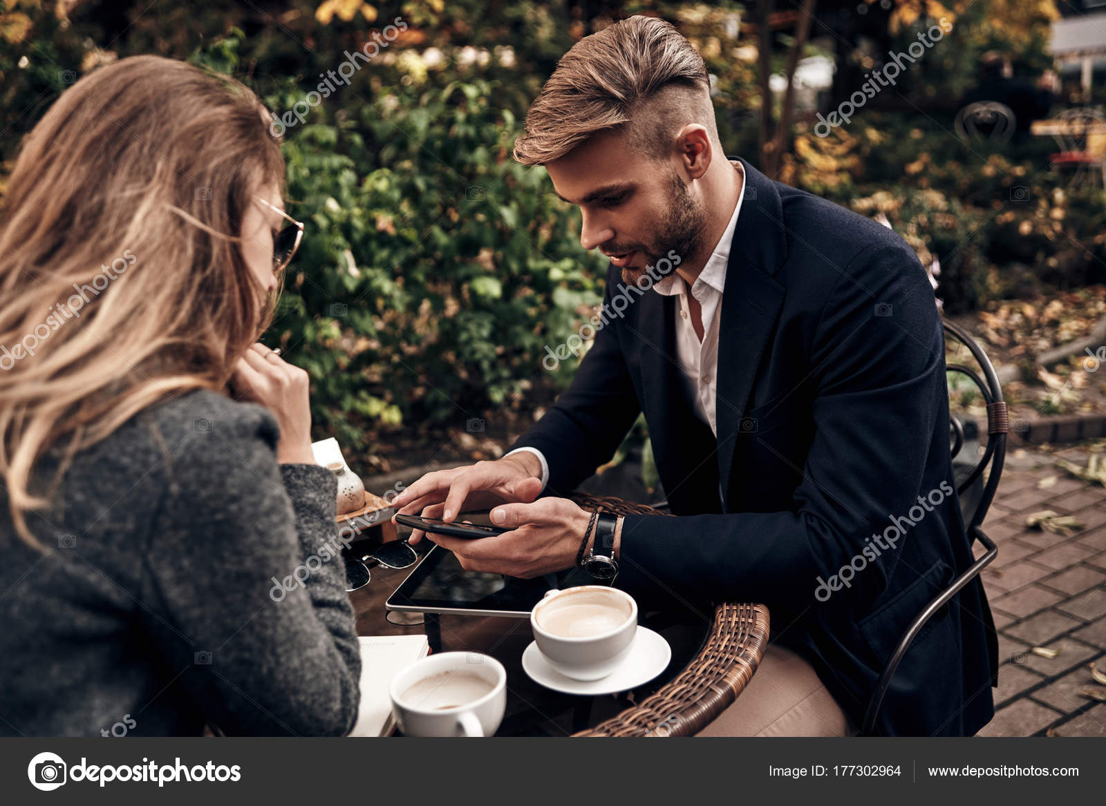 handsome young man having job interview woman coffee restaurant stock photo