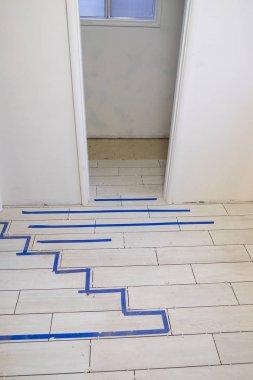 White Wood Grain Tiles at House Renovation