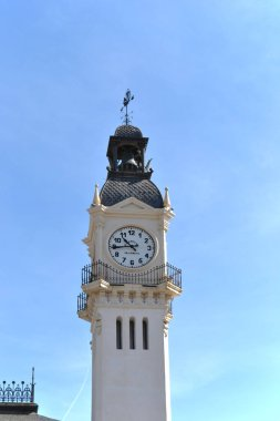 tower with big clock in summer