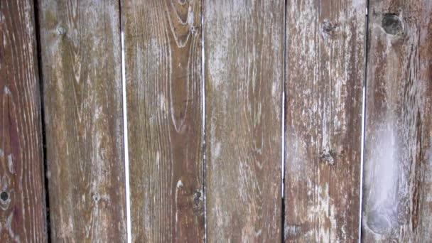 Sněhová bouře přes dřevěnou texturu
