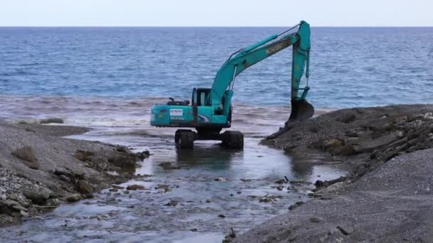 a backhoe at work in the shore