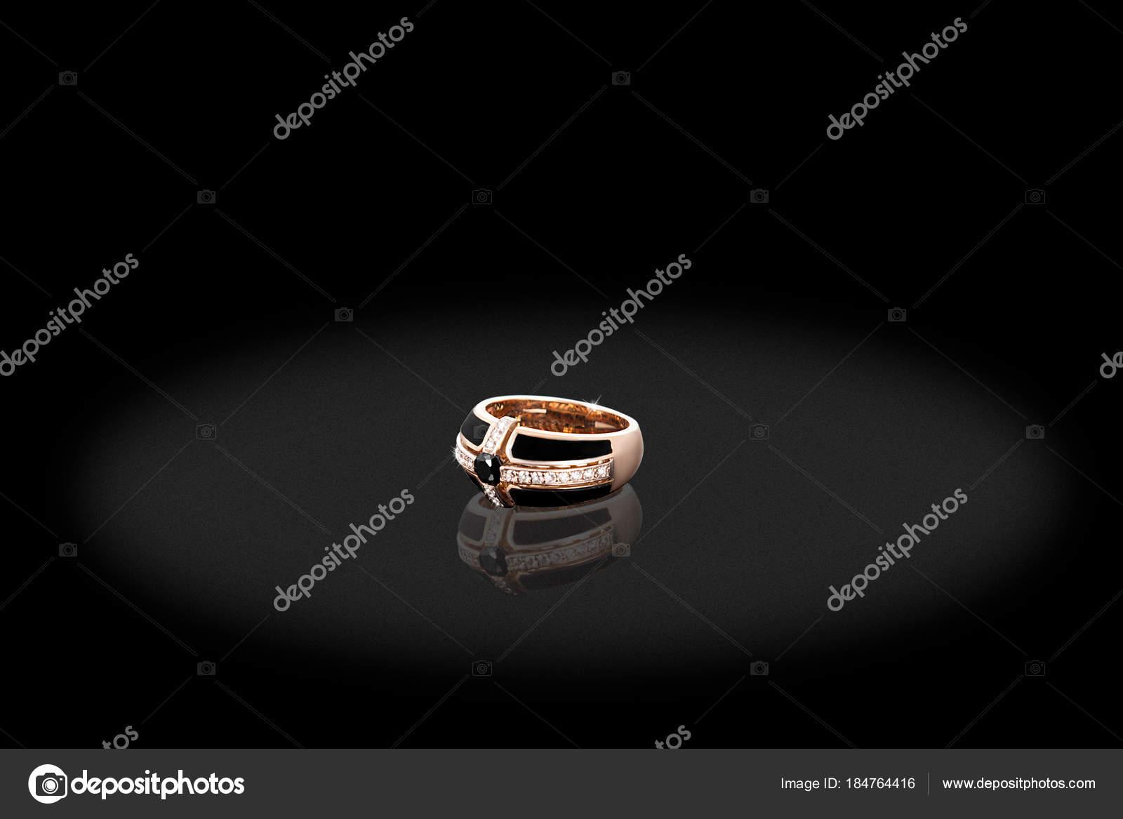 Yellow gold precious ring female with big diamonds on black background stock photo