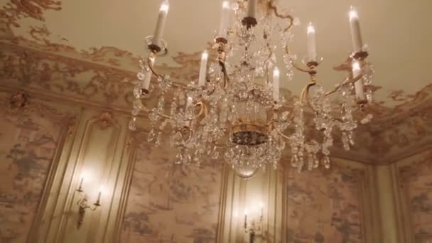 crystal chandelier weighs on the ceiling