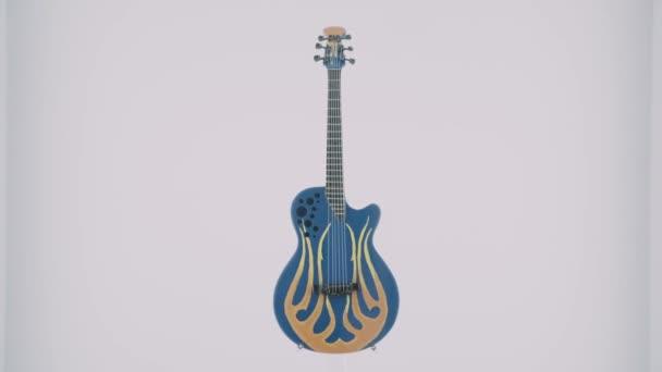 Malá modrá kytara se zajímavým vzorem stojí za brýlemi v krabici.