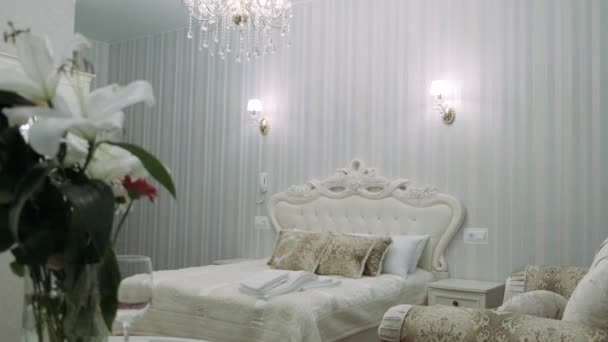 Beautiful beige bed with pillows and a white bedspread