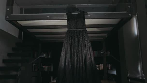 Black women`s wedding dress hanging in the room