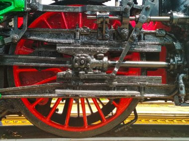 old red iron wheel of train