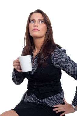 Young woman holding a cup of coffee in