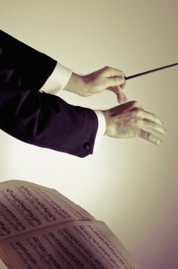 Close-up of conductor's hand holding a baton