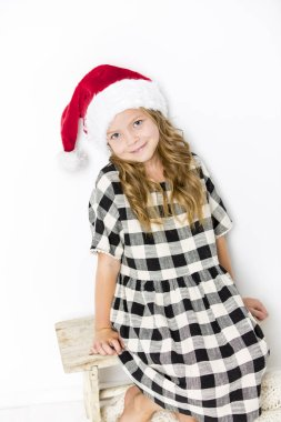happy christmas girl in santa hat on white background