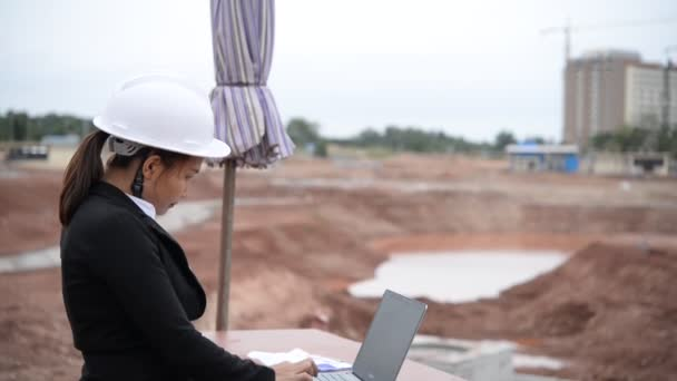 Engineer woman working at building project site