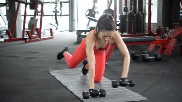 Asian sporty woman training in gym, workout video
