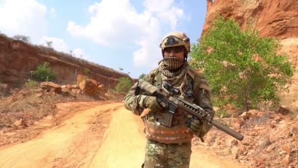 Soldier of special forces at desert during military operation, war theme