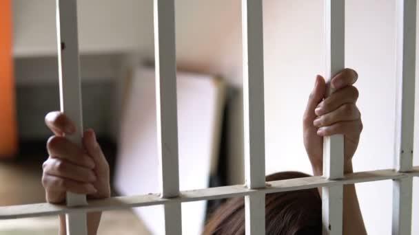 woman desperate to catch the iron prison,prisoner concept