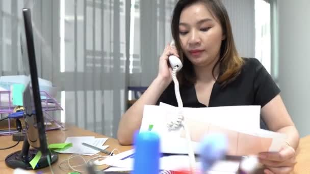 young Asian business woman working in modern office