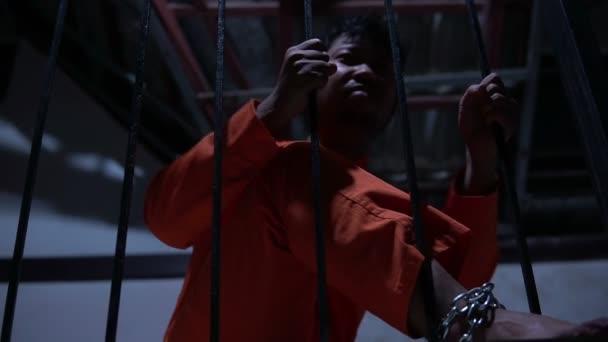 Asian man desperate at the iron prison, prisoner concept