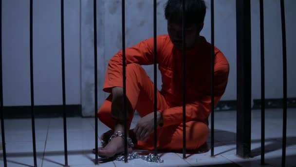 Asian man desperate at the iron prison, prisoner concept