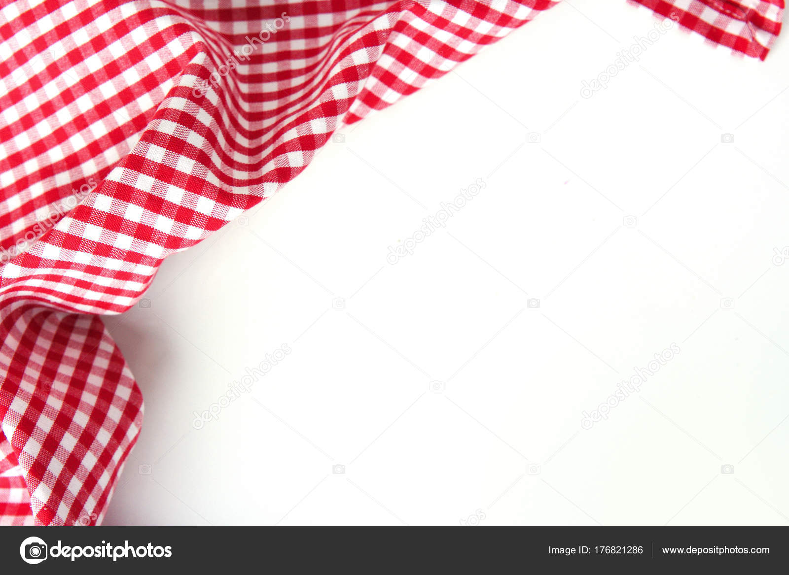 red checkere clothes on white table empty space background stock