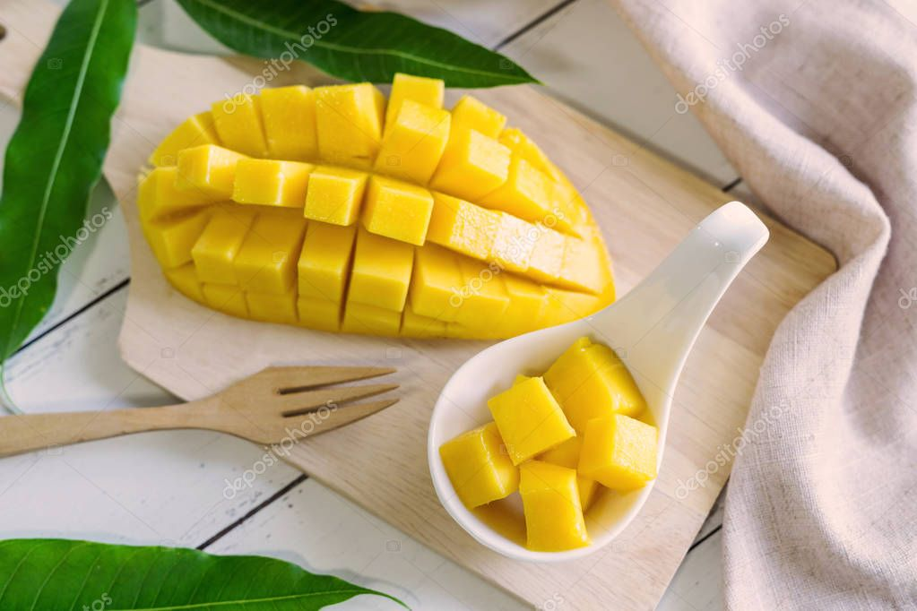 Ripe mango fruit and mango cubes