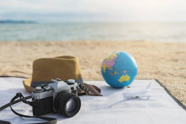 Camera, Hat and sunglasses on the beach