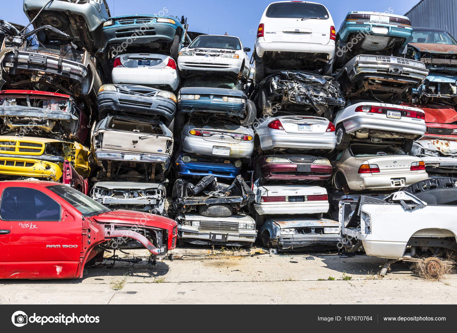 Indianapolis - Circa September 2017: Stacked junk yard clunker ...