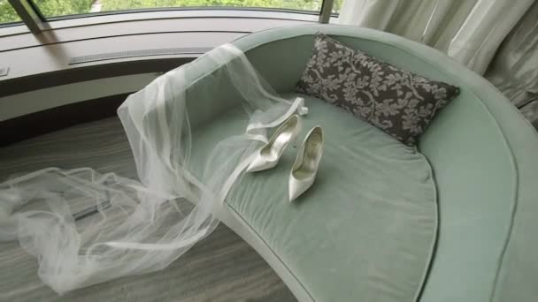Wedding accessories - shoes of the bride and veil. Smooth zoom in camera.