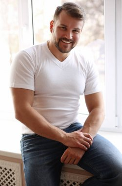 handsome sexy man with muscular sportive body , wears casual clo