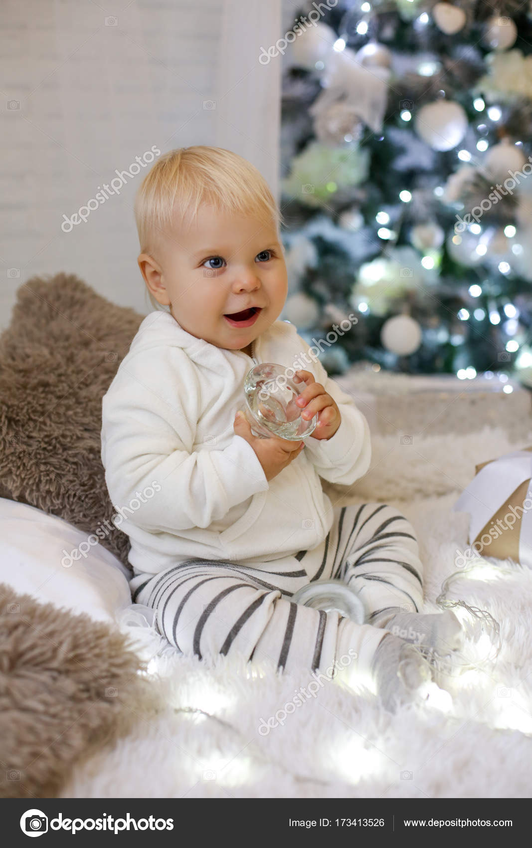 Cute 1 Year Old Baby Boy In Cozy Clothes Posing In New Year Dec