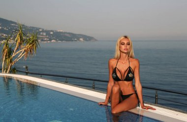 sexy woman with blond hair and perfect body, in luxurious bikini