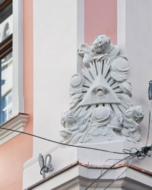 Eye of Providence (the all-seeing eye of God) sculptural composition on the facade of the old house in Lviv, Ukraine