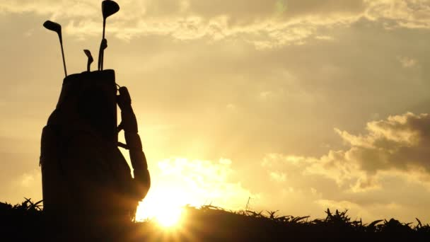 Silhouette golf athlete at the beautiful sunsets