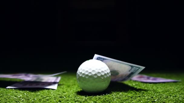 Slow motion of golf ball on green grass
