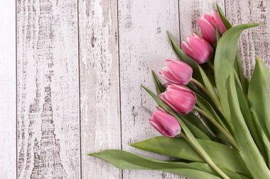 Bunch of tulips on wooden background. Tulips flower background