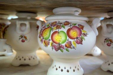 White painted earthenware samovars