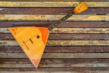 Musical instrument balalaika on wooden background