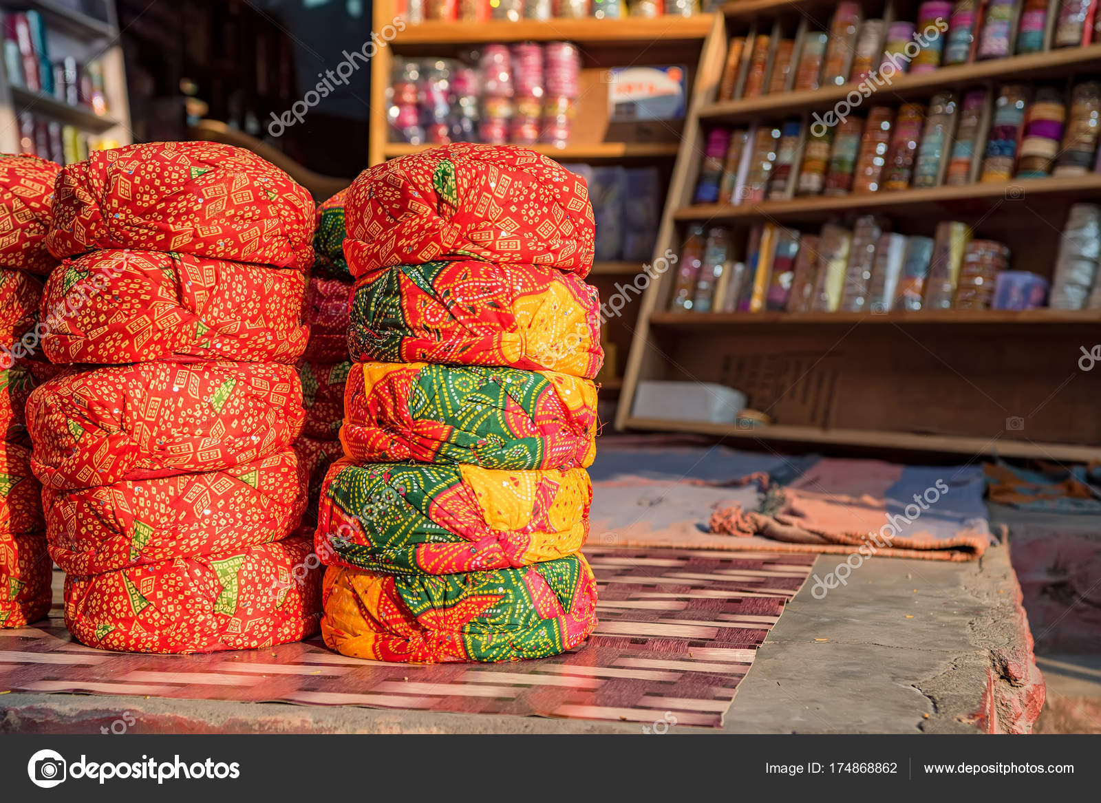 e419eb06 Close up stack of bright colorful hats of Indian rajah sold as souvenirs on  market — Photo by ...