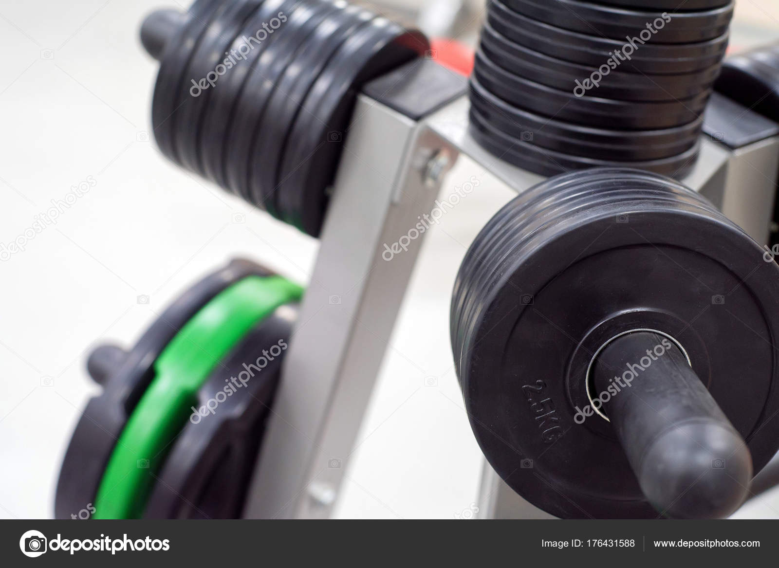 Dumbbell and barbell weight plates on plate holder. Rack with weghts or plate tree. Modern gym u2014 Photo by Yakov_Oskanov & Fitness dumbbell and barbell weight plates u2014 Stock Photo ...