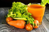 Healthy diet, glass of carrot juice and vegetables