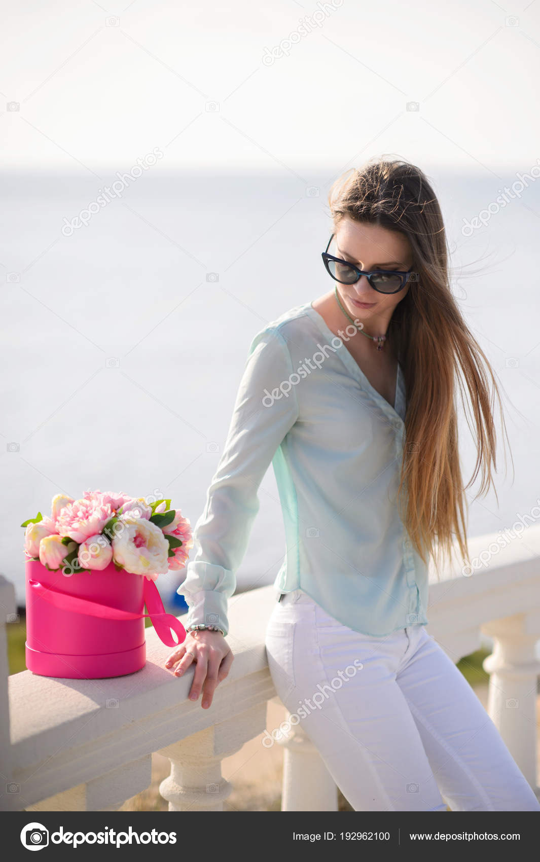 Beautiful girl with flowers in hands outdoors stock photo beautiful girl with flowers in hands outdoors stock photo izmirmasajfo