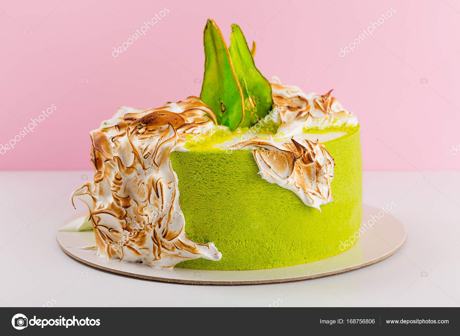 Green Cake Decorated With Burned Meringue And Colored Pear Slice