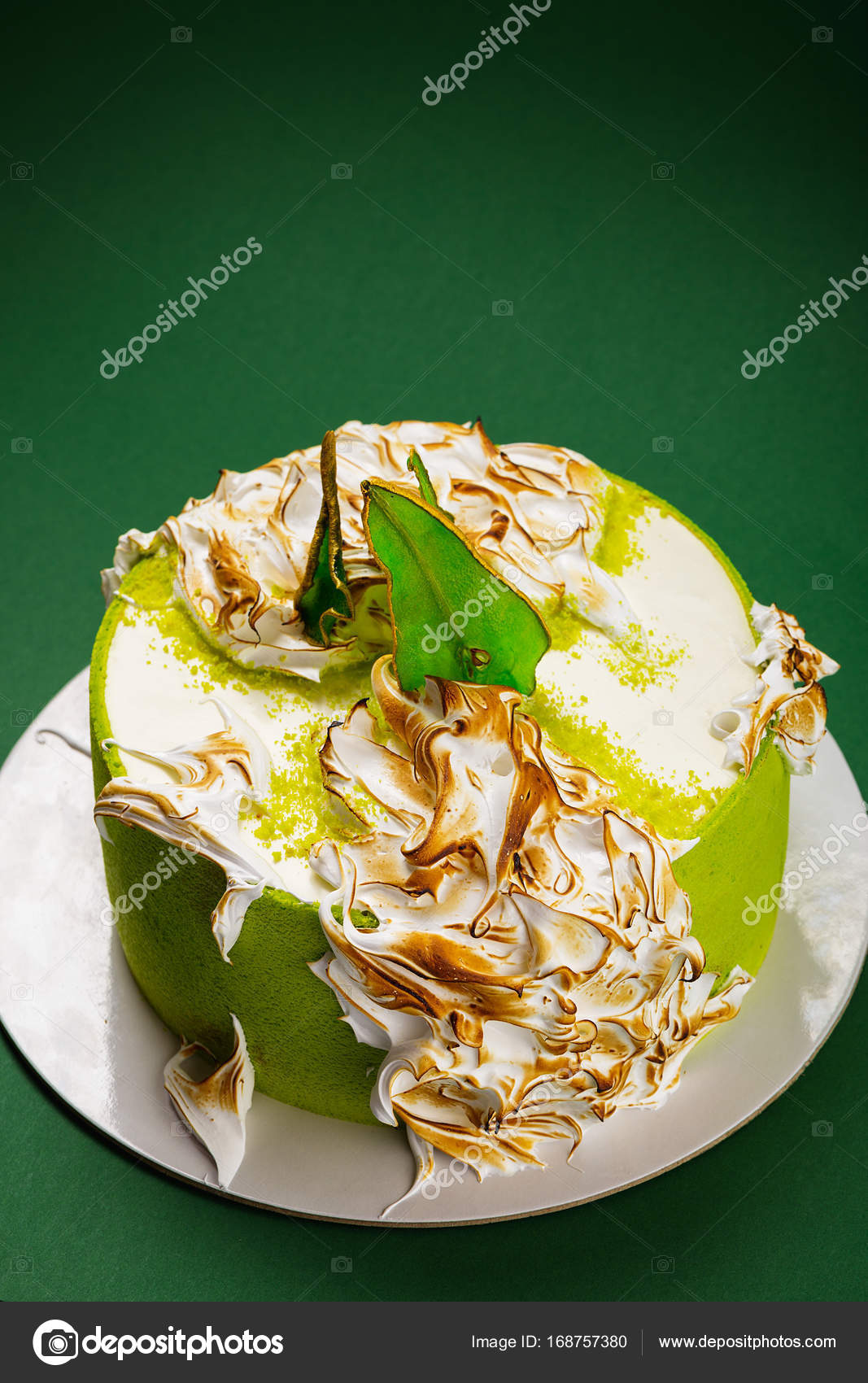 Birthday Cake With Burned Meringue And Colored Pear Slices On Gr