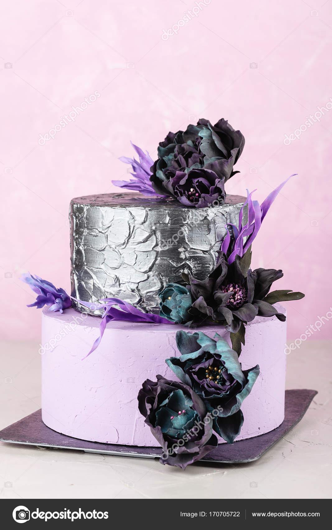 Tiered Wedding Cake With Black Fake Flowers Stock Photo