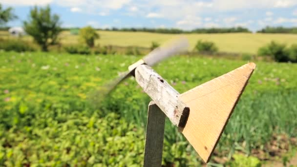 Homemade wooden airplane weather vane by the farm field– stock footage