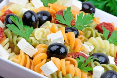 Fusilli with vegetable in a ceramic bowl