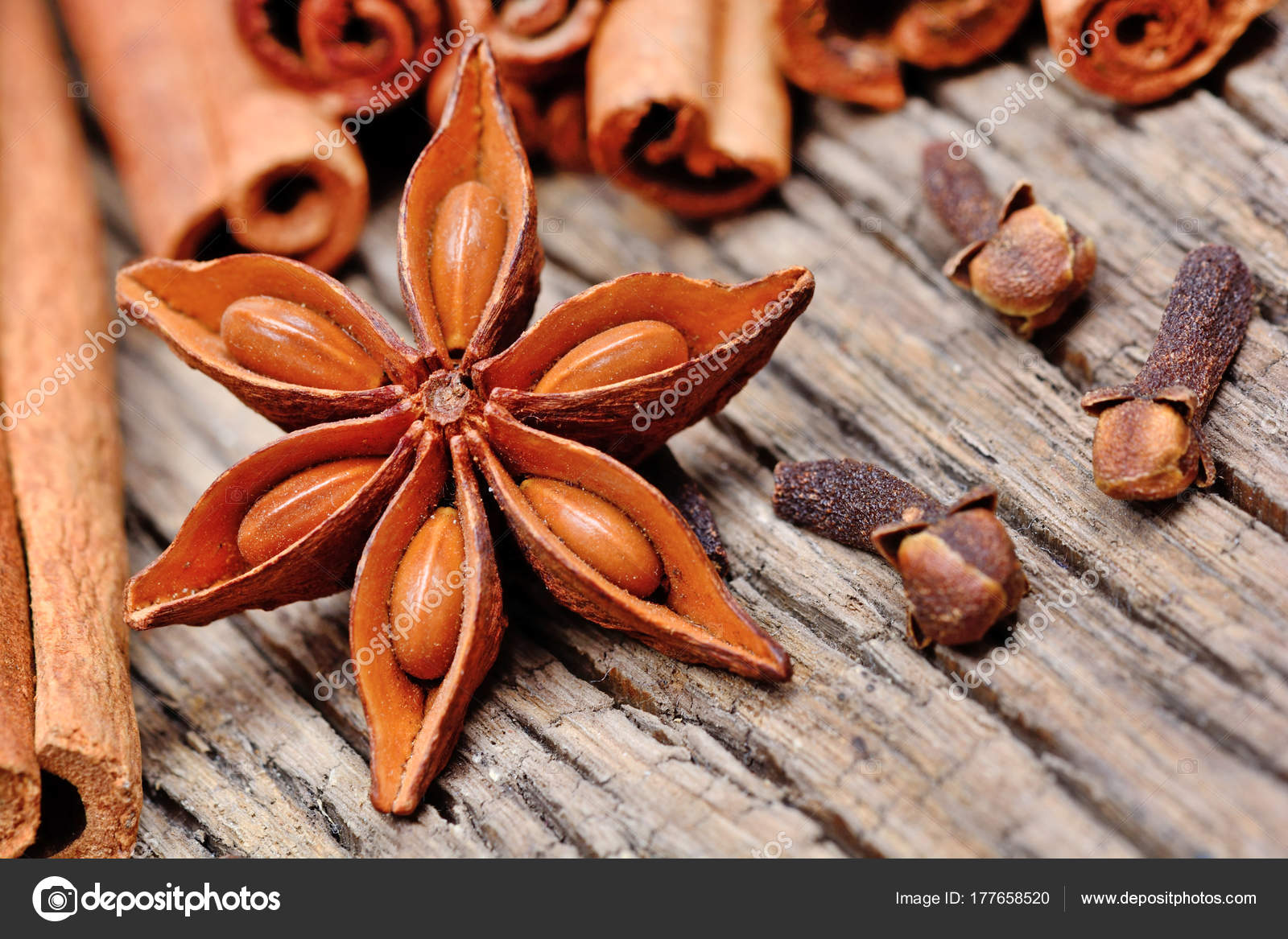 Anise Star With Cinnamon Sticks And Cloves On Rustic Wooden