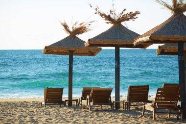 Black Sea beach with umbrellas stock vector