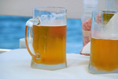 Two glasses of beer on the table