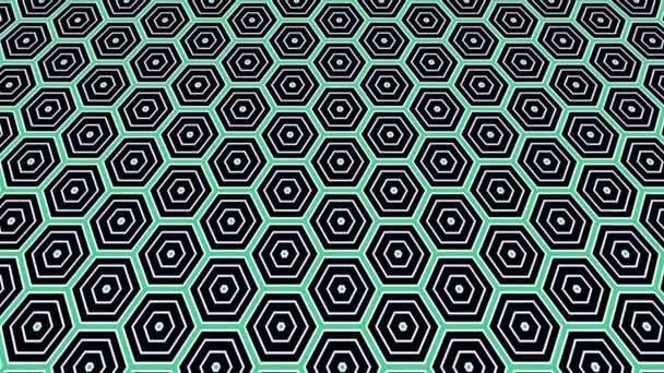 Grafický 2d video vzor, který se naklání a pohybuje, složený z designů a tvarů s mnohobarevnými texturami, ve formátu 4k 16: 9